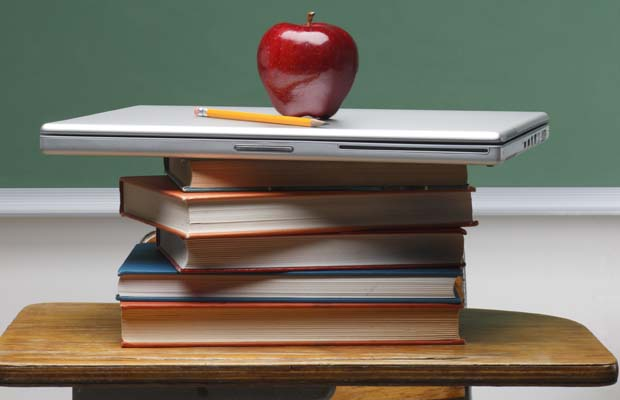 Apple and books on teacher's desk - not with Open English! (Credit: Google images)