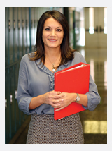 Teacher with red notebook