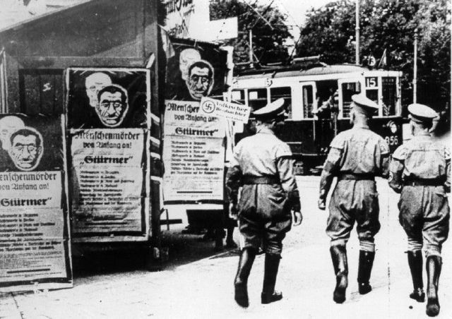 Der Sturmer posters on street corners in Germany